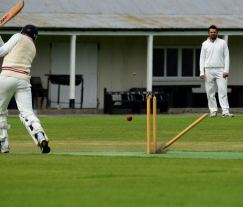 The bowler's reward... stumps and bails aflying... sending the batsman packing!!