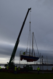 Boats need being afloat... so, Mr Crane Operator... swing them into the pond, would you please??