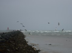 Poolbeg Lighthouse at the end of the Great South Wall... it sure does its job keeping out the ravages of the bay waves!