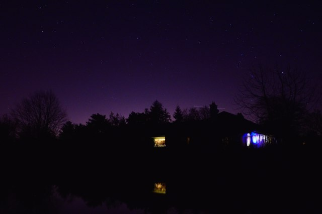 Orion lifts himself skyward for the last time in 2015. From me to you... a clear evening view across the pond at home. That's the kitchen window on the left... the Christmas tree lights on the right... HAPPY NEW YEAR!!