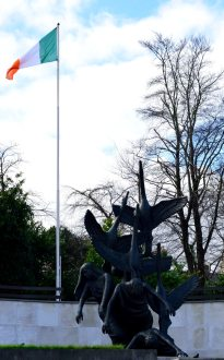 The Irish flag flies proudly over the Children of Lir in the Garden of Remembrance, Dublin, Ireland