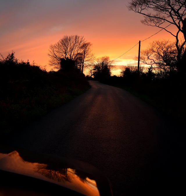 The sunset shimmering off the car's bonnet. Taken near Arklow, Co Wicklow - 16h09, 16 Dec 20160