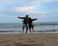 Two kids on the beach... waving 2016 goodbye and you all hello... and a bright, happy 2017!