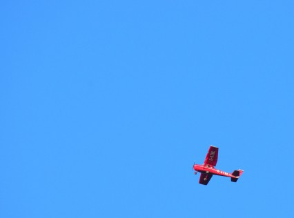 Red plane... blue sky... if you should ever wonder why?