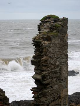 The wild sea... chewing at the cliff!