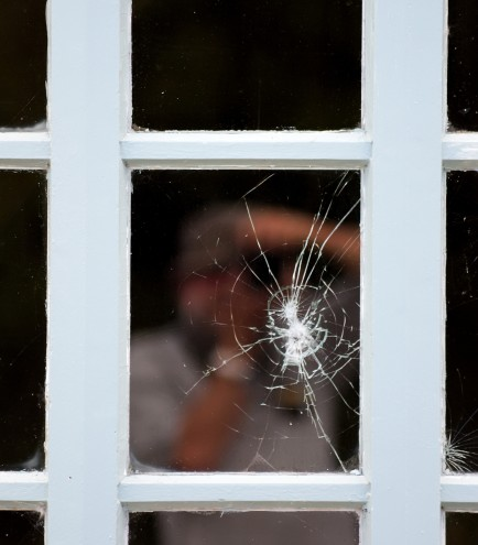 Cracked windowpane... reflections of my mind??