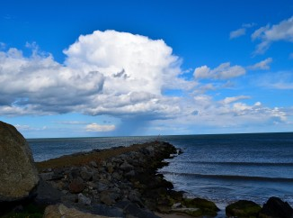 A rain squall passes over the Arklow Bank wind turbines. Summer on the Irish Sea!