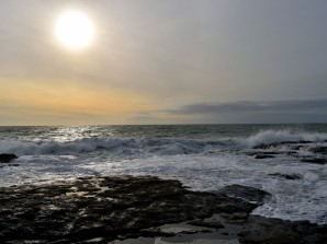 That's the sun in the distance... a very rocky coast somewhere in Co Wexford...