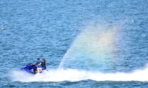 Riding the rainbow - capturing the moment - jet ski having fun along South Beach, Arklow, Co Wicklow, May bank holiday 2018