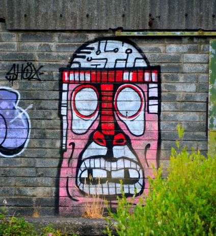 """""""Happy"""" face on the drab wall... adds colour to an otherwise grey industrial wasteland - Arklow"""