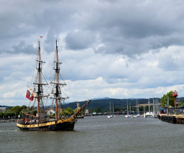 Tall ship Phoenix heads out of the harbour... the 19 Arches Bridge in the distance...